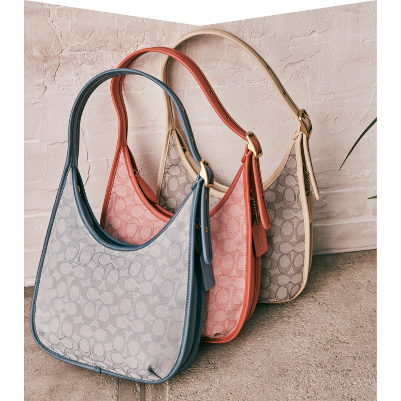 Blue, red and taupe purses.
