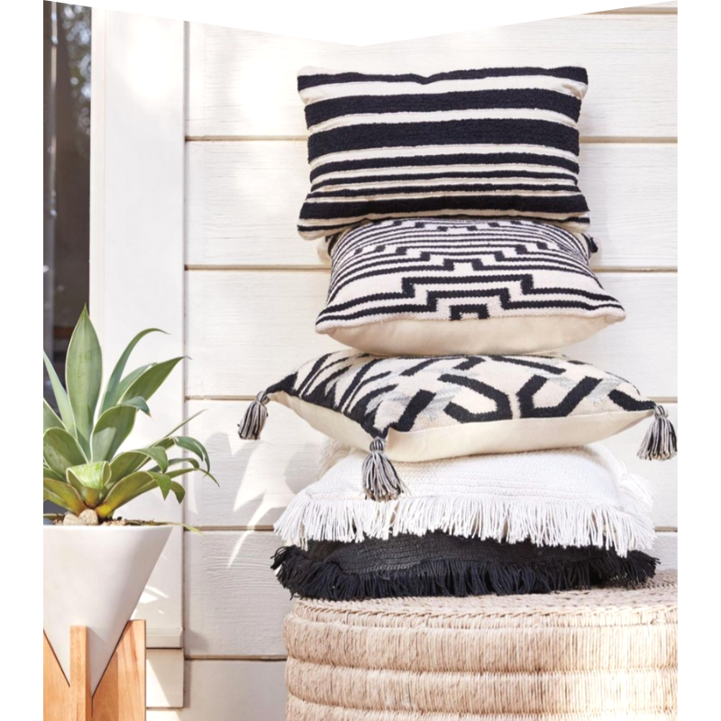 Five black and white pillows.